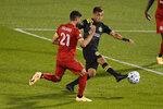 Columbus Crew's Hector Jimenez, right, is pressured by Toronto FC's Jonathan Osorio during the first half of an MLS soccer match, Sunday, Sept. 27, 2020, in East Hartford, Conn. (AP Photo/Jessica Hill)