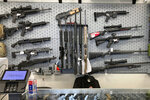 """FILE - In this Feb. 19, 2021, file photo, firearms are displayed at a gun shop in Salem, Ore. The first legal test of whether a wave of U.S. counties can legally declare themselves """"Second Amendment Sanctuaries,"""" and refuse to enforce certain gun laws is playing out in a rural Oregon logging county. The measure Columbia County voters narrowly approved last year bans local officials from enforcing most federal and state gun laws, which includes things like universal background checks or any prohibition on carrying guns. (AP Photo/Andrew Selsky, File)"""