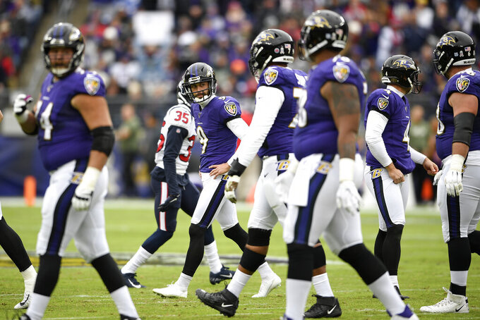 Baltimore Ravens kicker Justin Tucker, center left, reacts after missing a field goal against the Houston Texans during the first half of an NFL football game, Sunday, Nov. 17, 2019, in Baltimore. (AP Photo/Nick Wass)