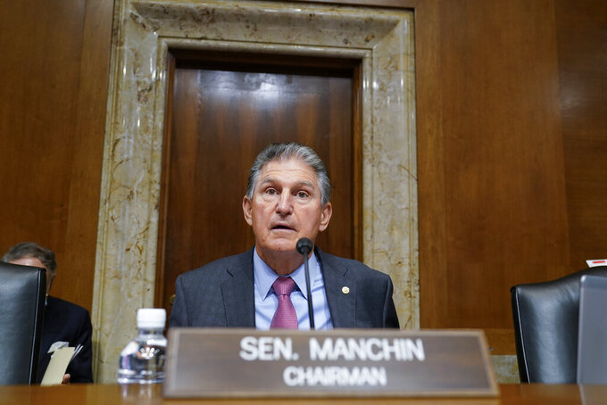 Sen. Joe Manchin, D-W.Va., arrives to chair the Senate Energy and Natural Resources Committee, as congressional Democrats speed ahead this week in pursuit of President Joe Biden's $3.5 trillion plan for social and environmental spending, at the Capitol in Washington, Tuesday, Sept. 21, 2021. Manchin, a Democratic senator vital to the bill's fate, has balked at the price tag. (AP Photo/J. Scott Applewhite)