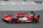 Filipe Nasr, of Brazil, drives the Wheelen Engineering Racing Cadillac DPi during a qualifying run to win the pole position for a race to determine positions for the Rolex 24 hour auto race at Daytona International Speedway, Saturday, Jan. 23, 2021, in Daytona Beach, Fla. (AP Photo/John Raoux)