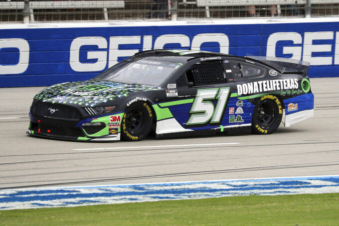 Joey Gase (51) drives down the front stretch during a NASCAR Cup Series auto race at Texas Motor Speedway in Fort Worth, Texas, Sunday, Oct. 25, 2020. (AP Photo/Richard W. Rodriguez)