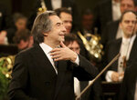 FILE - In this Jan. 1, 2018 file photo, Italian Maestro Riccardo Muti conducts the Vienna Philharmonic Orchestra during the traditional New Year's concert at the golden hall of Vienna's Musikverein, Austria.   Riccardo Muti, during a concert hje held at the Ravenna Festival, Sunday, June 21, 2020, has sent a resounding message that live classical music has returned the Italian stage after the coronavirus lockdown with a full summer festival program in his adopted Ravenna. (AP Photo/Ronald Zak, File)
