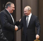 Russian President Vladimir Putin, right, and U.S. Secretary of State Mike Pompeo, greet each other prior to their talks in the Black Sea resort city of Sochi, southern Russia, Tuesday, May 14, 2019. Pompeo arrived in Russia for talks that are expected to focus on an array of issues including arms control and Iran. (Alexander Nemenov/Pool Photo via AP)