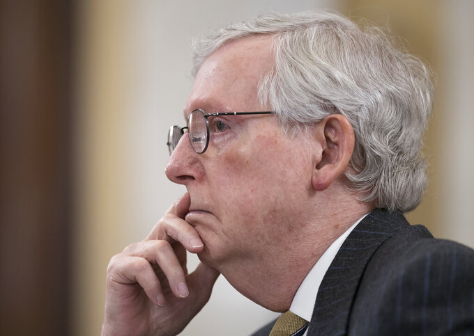 """FILE - In this March 24, 2021, file photo Senate Minority Leader Mitch McConnell, R-Ky., listens as the Senate Rules Committee holds a hearing on the """"For the People Act,"""" which would expand access to voting and other voting reforms, at the Capitol in Washington. McConnell, a onetime ally of former President Donald Trump who ushered the former president's legislative and judicial agenda to fruition, but now claims to want nothing to do with Trump. (AP Photo/J. Scott Applewhite, File)"""