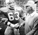 FILE - In this Dec. 16, 1984, file photo, Tampa Bay Buccaneers defensive end Lee Roy Selmon bids retiring coach John McKay farewell after the Buccaneers defeated the New York Jets 41-21 in an NFL football game in Tampa, Fla. Selmon was the first draft pick in team history, No. 1 overall in 1976 by an expansion franchise that within four seasons went from losing its first 26 games to within one victory of a Super Bowl appearance. Selmon was one of the NFL's most dominant pass rushers and the first Tampa Bay player elected to the Pro Football Hall of Fame. (AP Photo/Bruce Zake, File)
