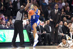 Duke forward Wendell Moore Jr. (0) reacts to the foul against Wake Forest guard Brandon Childress (0) in double overtime of an NCAA college basketball game Tuesday, Feb. 25, 2020, in Winston-Salem, N.C. (AP Photo/Lynn Hey)