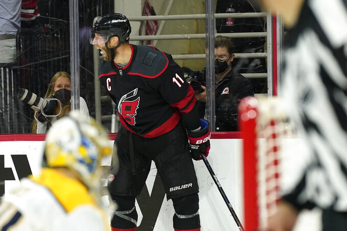 Carolina Hurricanes center Jordan Staal (11) reacts after scoring against the Nashville Predators during overtime in Game 5 of an NHL hockey Stanley Cup first-round playoff series in Raleigh, N.C., Tuesday, May 25, 2021. (AP Photo/Gerry Broome)