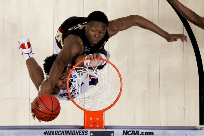 Florida State forward Mfiondu Kabengele, top, blocks a shot by Gonzaga forward Rui Hachimura during the first half of an NCAA men's college basketball tournament West Regional semifinal Thursday, March 28, 2019, in Anaheim, Calif. (AP Photo/Marcio Jose Sanchez)