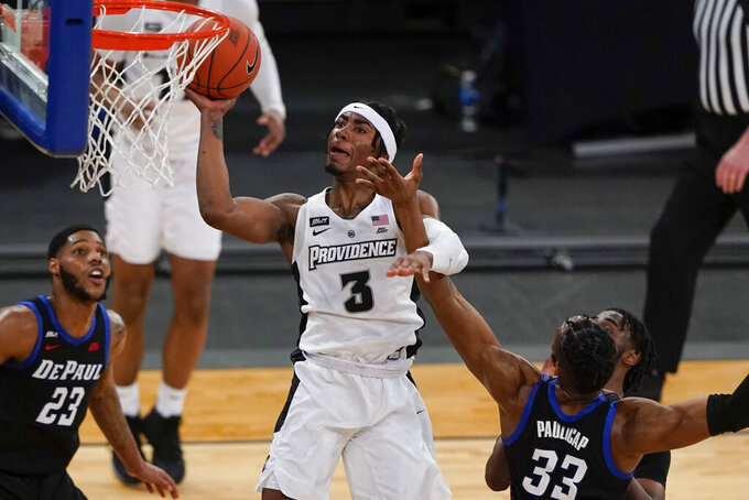 Providence's David Duke (3) drives past DePaul's Pauly Paulicap (33) during the second half of an NCAA college basketball game in the Big East conference tournament Wednesday, March 10, 2021, in New York. (AP Photo/Frank Franklin II)