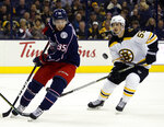 Columbus Blue Jackets forward Matt Duchene, left, and Boston Bruins forward Noel Acciari chase the puck during the second period of an NHL hockey game in Columbus, Ohio, Tuesday, March 12, 2019. (AP Photo/Paul Vernon)