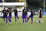 Orlando City players warm up wearing Black Lives matter t-shirts before an MLS soccer match against the Montreal Impact, Saturday, July 25, 2020, in Kissimmee, Fla. (AP Photo/John Raoux)