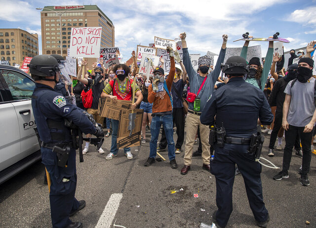 Protesters face off with police as they shut down southbound Interstate 35 freeway in Austin Texas, Saturday, May 30, 2020. Demonstrators were protesting the death of George Floyd, a black man who was killed in police custody in Minneapolis on May 25. (Ricardo B. Brazziell/Austin American-Statesman via AP)