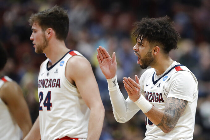 Gonzaga guard Josh Perkins, right, celebrates after scoring against Florida State during the first half an NCAA men's college basketball tournament West Region semifinal Thursday, March 28, 2019, in Anaheim, Calif. (AP Photo/Marcio Jose Sanchez)