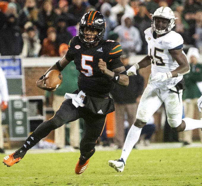Miami quarterback N'Kosi Perry (5) rushes as Georgia Tech defensive back Charlie Thomas follows during the second half of an NCAA college football game Saturday, Nov. 10, 2018, in Atlanta. Georgia Tech won 27-21. (AP Photo/John Amis)
