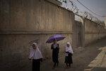 Girls walk to their school before class in Kabul, Afghanistan, Sunday, Sept. 12, 2021. (AP Photo/Felipe Dana)