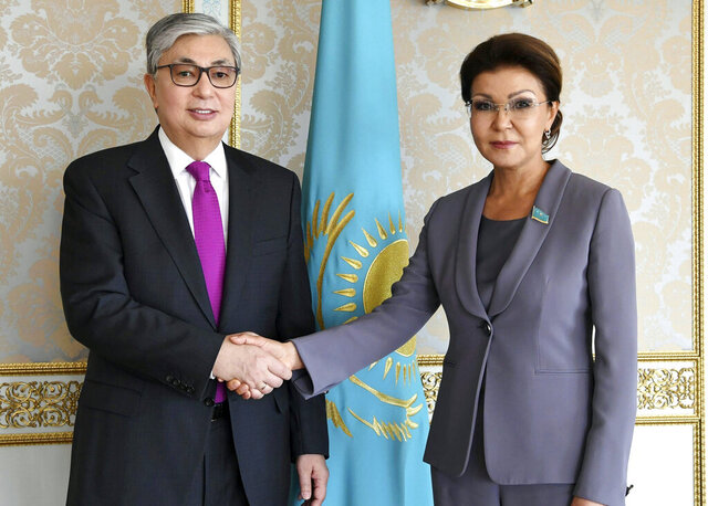 In this photo taken on Wednesday, March 20, 2019, Kazakhstan's interim president Kassym-Jomart Tokayev, left, and Dariga Nazarbayeva, daughter of Kazakhstan's former president Nursultan Nazarbayev, shake hands in Astana, Kazakhstan. The daughter of Kazakhstan's former president, once viewed as his heir-apparent, has been dismissed from her post as speaker of the country's senate. Dariga Nazarbayeva was removed Saturday, May 2, 2020 by an order from President Kassym-Jomart Tokayev; she also lost her seat in the senate. (Kazakhstan's Presidential Press Service via AP, File)