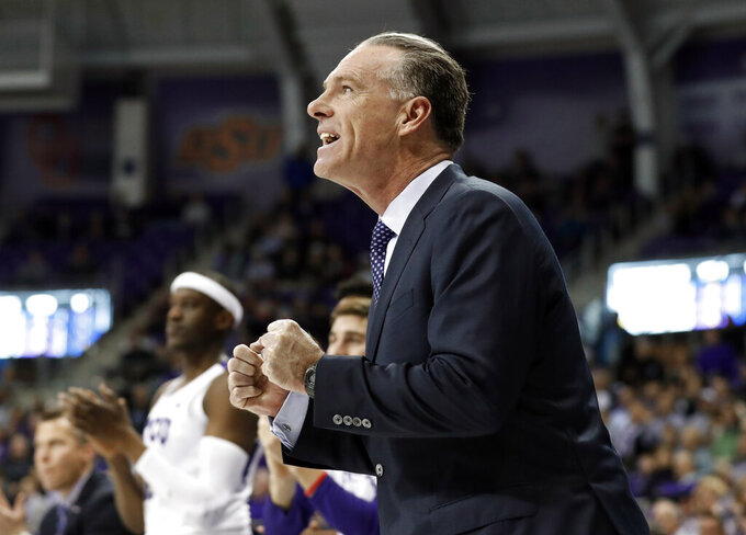 TCU head coach Jamie Dixon celebrates a basket against Kansas State in the first half of an NCAA college basketball game in Fort Worth, Texas, Monday, March 4, 2019. (AP Photo/Tony Gutierrez)