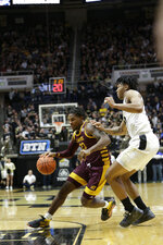 Central Michigan guard Dallas Morgan (23) dribbles around Purdue guard Nojel Eastern (20) during the first half of an NCAA college basketball game in West Lafayette, Ind., Saturday, Dec. 28, 2019. (Nikos Frazier/Journal & Courier via AP)