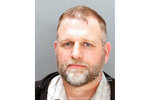 This undated booking photo provided by the Ada County Sheriff's Office shows Ammon Bundy who was arrested Thursday, April 8, 2021 on a misdemeanor charge of trespassing at the Idaho Statehouse. It's the fourth time the man known for leading a 2016 armed standoff at an Oregon wildlife refuge has been arrested in Boise since August, and his third arrest to occur at the state Capitol building. (Ada County Sheriff's Office via AP)