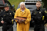Former Penn State University assistant football coach Jerry Sandusky, center, arrives at the Centre County Courthouse to be resentenced Friday, Nov. 22, 2019, in Bellefonte, Pa. Sandusky was convicted of 45 counts of child sexual abuse in 2012 and sentenced to 30 to 60 years. (AP Photo/Gene J. Puskar)