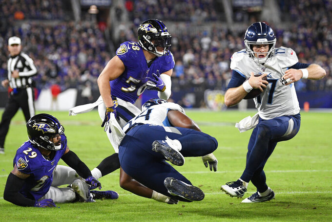 Tennessee Titans quarterback Ryan Tannehill (17) runs to the end zone for a touchdown against the Baltimore Ravens during the second half of an NFL divisional playoff football game, Saturday, Jan. 11, 2020, in Baltimore. (AP Photo/Nick Wass)