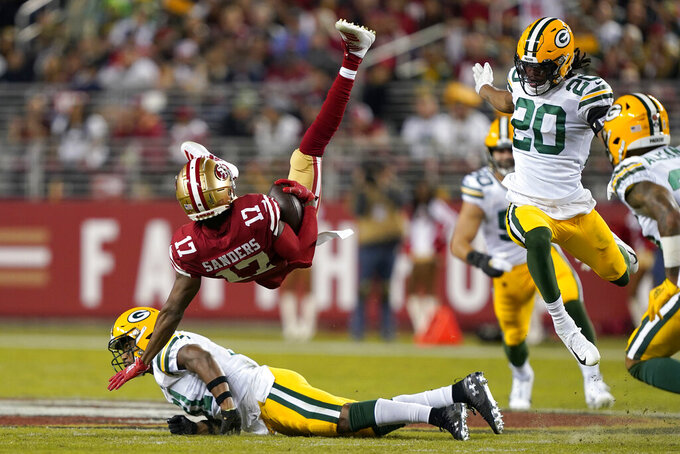 San Francisco 49ers wide receiver Emmanuel Sanders (17) falls backward over Green Bay Packers strong safety Adrian Amos during the first half of an NFL football game in Santa Clara, Calif., Sunday, Nov. 24, 2019. (AP Photo/Tony Avelar)