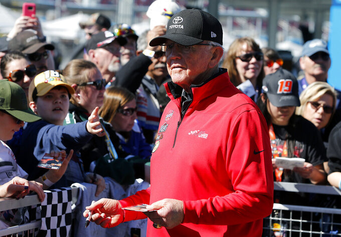 Team owner Joe Gibbs signs autographs for fans prior to the start of the NASCAR Cup Series auto race at ISM Raceway, Sunday, March 10, 2019, in Avondale, Ariz. (AP Photo/Ralph Freso)