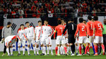 FILE - In this April 1, 2009, file photo, North Korean players, wearing white uniforms, shake hands with South Korean players after their 2010 FIFA World Cup Asia group 2 qualifying soccer match at Seoul World Cup Stadium in Seoul, South Korea. South Korean officials say North Korea has told soccer's Asian governing body it will not participate in World Cup qualifiers next month because of coronavirus concerns. Kim Min-soo, an official from the Seoul-based Korean Football Association, on Tuesday, May 4, 2021, said the Asian Football Confederation has requested North Korea to reconsider its decision. He said the North notified the AFC last week of its intent to drop out of the matches.(AP Photo/ Lee Jin-man, File)