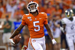 FILE - In this Sept. 21, 2019, file photo, Clemson's Tee Higgins reacts after scoring a touchdown during the first half of the team's NCAA college football game against Charlotte, in Clemson, S.C. Higgins was selected to The Associated Press All-Atlantic Coast Conference football team, Tuesday, Dec. 10, 2019. (AP Photo/Richard Shiro, File)