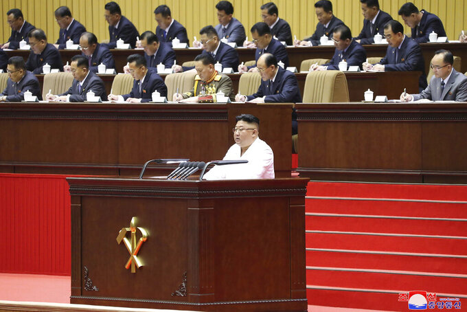 """In this photo provided by the North Korean government, North Korean leader Kim Jong Un delivers an opening speech at a conference of the Workers' Party's cell secretaries in Pyongyang, North Korea, Tuesday, April 6, 2021. Kim has acknowledged his country was facing the """"worst-ever situation"""" as he addressed thousands of grassroots members of his ruling party during the major political conference. Independent journalists were not given access to cover the event depicted in this image distributed by the North Korean government. The content of this image is as provided and cannot be independently verified. Korean language watermark on image as provided by source reads: """"KCNA"""" which is the abbreviation for Korean Central News Agency. (Korean Central News Agency/Korea News Service via AP)"""