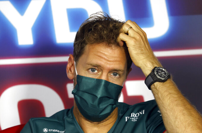 Aston Martin driver Sebastian Vettel of Germany attends a media conference at the Hungaroring racetrack in Mogyorod, Hungary, Thursday, July 29, 2021. The Hungarian Formula One Grand Prix will be held on Sunday. (Florion Goga/Pool via AP)