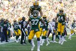 Green Bay Packers' Josh Jackson (37) and Allen Lazard (13) celebrate after the opening kickoff during the first half of an NFL football game against the Chicago Bears Sunday, Dec. 15, 2019, in Green Bay, Wis. (AP Photo/Morry Gash)
