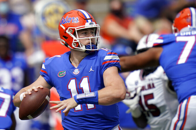 Florida quarterback Kyle Trask (11) throws a pass against South Carolina during the first half of an NCAA college football game, Saturday, Oct. 3, 2020, in Gainesville, Fla. (AP Photo/John Raoux,Pool)