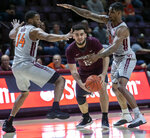FILE - In this Dec. 28, 2018, file photo, Virginia Tech forward P.J. Horne (14) and guard Ahmed Hill (13) defend against Maryland-Eastern Shore guard Bryan Urrutia, center, during the first half of an NCAA college basketball game, in Blacksburg, Va. Virginia Tech is enjoying one of the best starts to a basketball season in program history, and one of the keys to the Hokies' success has been an increased attention to defense. (AP Photo/Don Petersen, File)