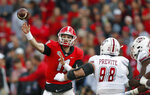 Georgia quarterback Jake Fromm (11) throws a pass as Massachusetts defensive lineman Joe Previte (98) rushes during the first half of an NCAA college football game Saturday, Nov. 17, 2018, in Athens, Ga. (AP Photo/John Bazemore)