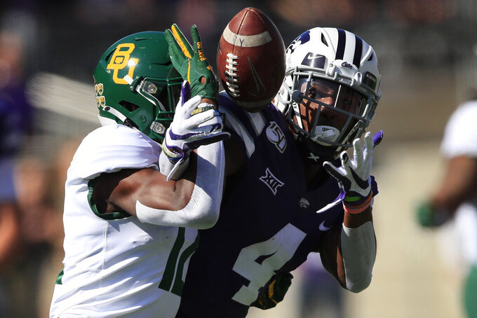 Baylor cornerback Kalon Barnes, left, breaks up a pass intended for Kansas State wide receiver Malik Knowles, right, during the first half of an NCAA college football game in Manhattan, Kan., Saturday, Oct. 5, 2019. (AP Photo/Orlin Wagner)