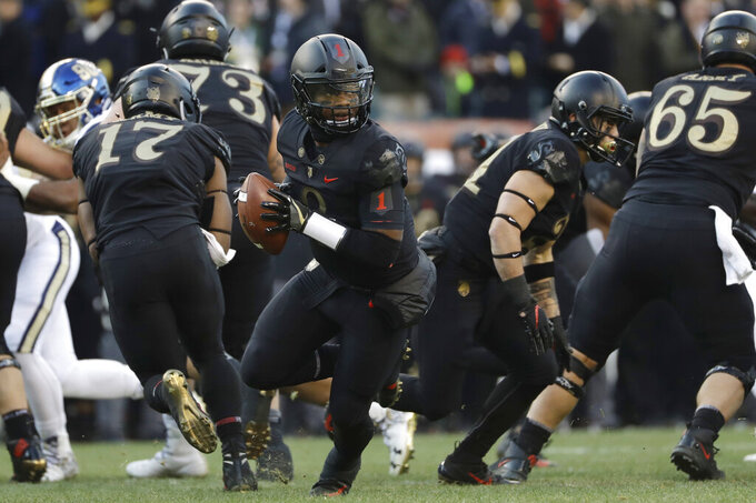 FILE - In this Dec. 8, 2018, file photo, Army quarterback Kelvin Hopkins Jr. drops back during the first half of an NCAA college football game against Navy, in Philadelphia.  Army is coming off a year like no other in the storied history of the football program. (AP Photo/Matt Slocum, File)