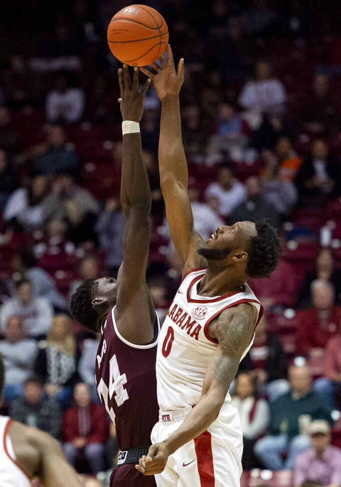 Alabama forward Donta Hall (0) wins the tip-off from Mississippi State forward Abdul Ado (24) during the first half of an NCAA college basketball game, Tuesday, Jan. 29, 2019, in Tuscaloosa, Ala. (AP Photo/Vasha Hunt)