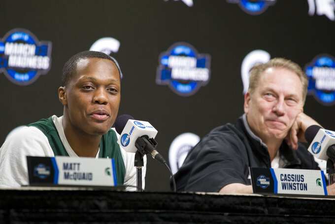Michigan State guard Cassius Winston, left,  next to head coach Tom Izzo, speaks during an NCAA men's college basketball news conference in Washington, Saturday, March 30, 2019. Michigan State plays Duke in the East Regional final game on Sunday. (AP Photo/Alex Brandon)