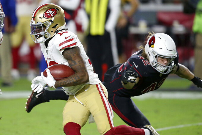 San Francisco 49ers wide receiver Richie James, left, runs as Arizona Cardinals linebacker Dennis Gardeck (42) defends during the second half of an NFL football game, Thursday, Oct. 31, 2019, in Glendale, Ariz. (AP Photo/Ross D. Franklin)