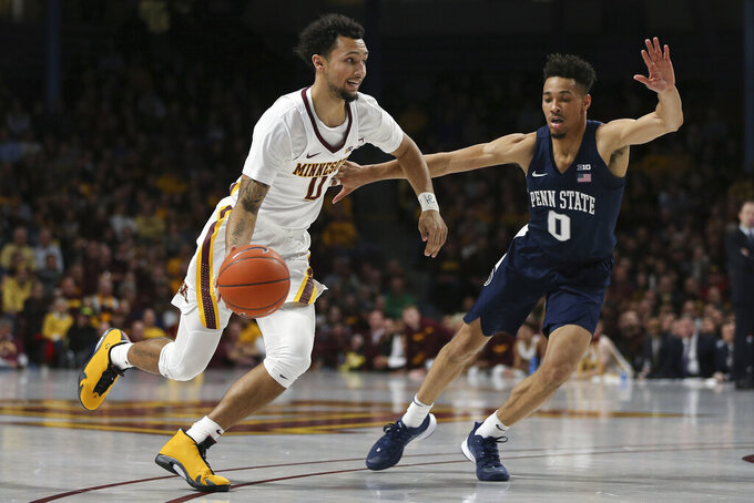 FILE - In this Jan. 15, 2020, file photo, Minnesota's Payton Willis drives the ball past Penn State's Myreon Jones during an NCAA college basketball game in Minneapolis. Willis is one of several transfers who joined new coach Ben Johnson's team, after playing for Charleston last season. He was with Minnesota in 2019-20.(AP Photo/Stacy Bengs, File)