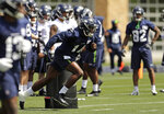 Seattle Seahawks wide receiver DK Metcalf, center, takes off on a drill during NFL football rookie mini camp, Friday, May 3, 2019, in Renton, Wash. (AP Photo/Ted S. Warren)