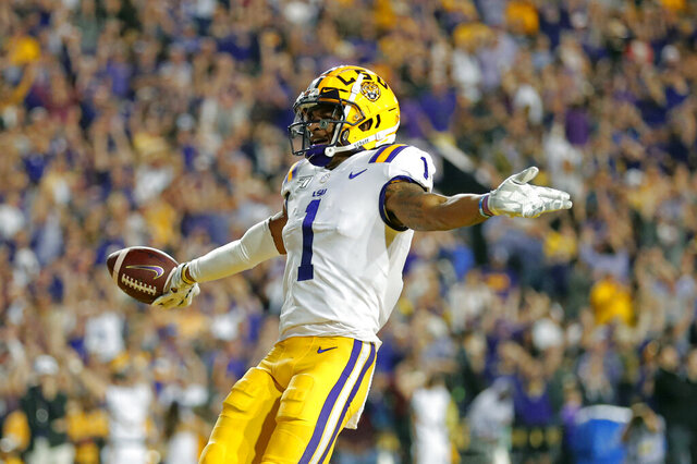 FILE - In this Nov. 30, 2019, file photo, LSU wide receiver Ja'Marr Chase (1) celebrates his touchdown reception during the first half of the team's NCAA college football game against Texas A&M, in Baton Rouge, La. Chase was selected to The Associated Press All-America team, Monday, Dec. 16, 2019.  (AP Photo/Gerald Herbert, File)