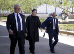 Defendant David McBride, left, leaves court with lawyers Bernard Collaery, right, and Natalija Nikolic after McBride's court appearance in Canberra, Australia, Friday, Feb. 14, 2020. Collaery is charged with conspiring to reveal classified information that expose a diplomatic scandal and McBride is charged with leaking secret documents alleging military misconduct in Afghanistan. (AP Photo/Rod McGuirk)