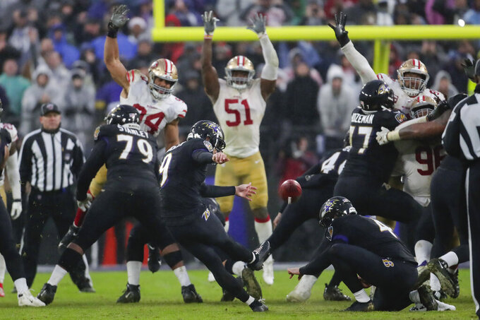 Baltimore Ravens kicker Justin Tucker (9) kicks the game winning field goal against the San Francisco 49ers in the second half of an NFL football game, Sunday, Dec. 1, 2019, in Baltimore, Md. Ravens won 20-17. (AP Photo/Julio Cortez)