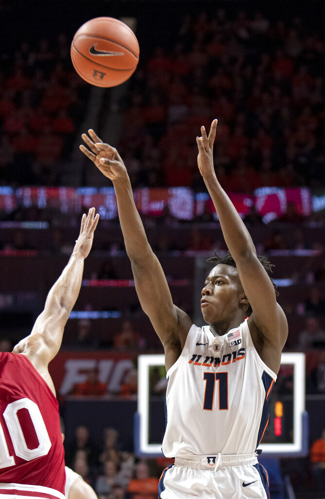 Illinois guard Ayo Dosunmu (11) shoots over Indiana guard Rob Phinisee (10) during the first half of an NCAA college basketball game in Champaign, Ill., Thursday, March 7, 2019. (AP Photo/Stephen Haas)