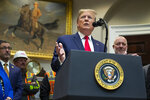 President Donald Trump delivers remarks on proposed changes to the National Environmental Policy Act, at the White House, Thursday, Jan. 9, 2020, in Washington. (AP Photo/ Evan Vucci)
