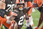 Cleveland Browns running back Kareem Hunt (27) celebrates after a 5-yard touchdown during the second half of an NFL football game against the Baltimore Ravens, Monday, Dec. 14, 2020, in Cleveland. (AP Photo/David Richard)