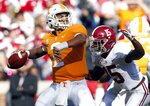 Tennessee quarterback Jarrett Guarantano (2) attempts to throw to a receiver as he is pressured by Alabama defensive back Xavier McKinney (15) in the first half of an NCAA college football game against Alabama Saturday, Oct. 20, 2018, in Knoxville, Tenn. (AP Photo/Wade Payne)